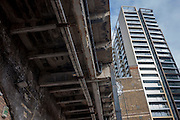 Old railway bridge concrete and new architecture at Elephant Park, at Elephant & Castle, London borough of Southwark. Southwark Council's development partner, Lendlease is regenerating over 28 acres across three sites at the heart of Elephant & Castle, in what is the latest major regeneration opportunity in zone 1 London. The vision for the £1.5 billion regeneration is to build on the area's strengths and vibrant character in order to re-establish Elephant & Castle as one of London's most flourishing urban quarters. The Elephant & Castle regeneration is of a scale rarely seen in central London and includes almost 3,000 new homes, plus office, retail, community, leisure and restaurant space.