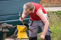 A blacksmith working at the Essex Country Show, Barleylands, Essex.