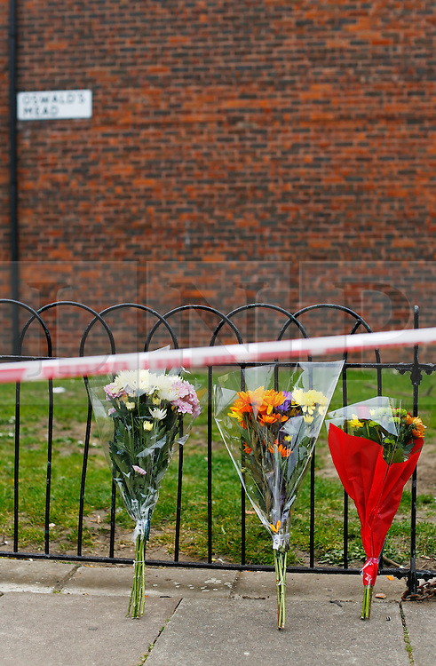 © Licensed to London News Pictures. London, UK. 31/03/2014. Flowers left at the scene where police officers investigate the murder of a mother and her daughter at their home in Oswald Mead, Homerton. They found a 45-year old woman, a 23-month old baby girl and a 53-year old man suffering from injuries this morning (31/03/14). The man was taken to a hospital in east London and has been arrested on suspicion of murder. Photo credit: LNP