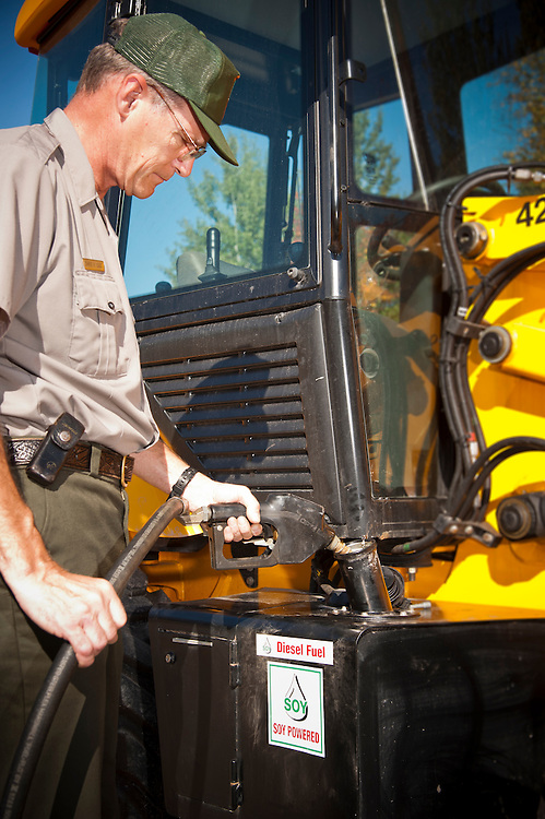 Pictured Rocks National Lakeshore facility manager Chris Case filling a backhoe with soy-based biodiesel fuel.