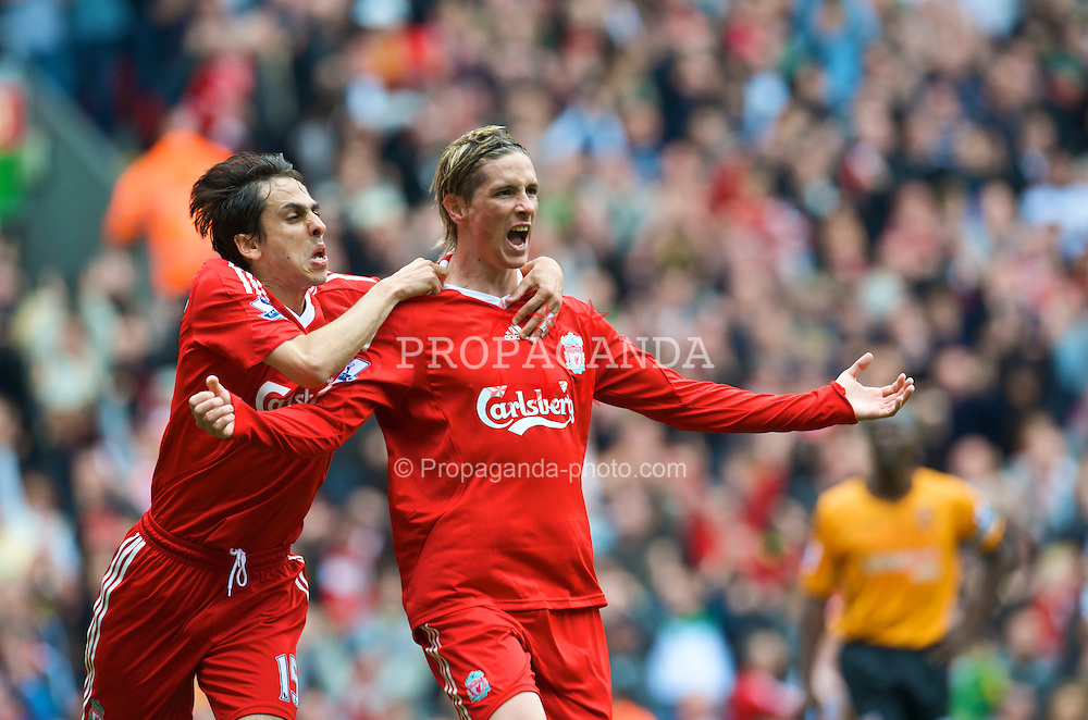 LIVERPOOL, ENGLAND - Saturday, September 26, 2009: Liverpool's Fernando Torres celebrates scoring his, and his side's second goal with team-mate Yossi Benayoun during the Premiership match at Anfield. (Photo by: David Rawcliffe/Propaganda)