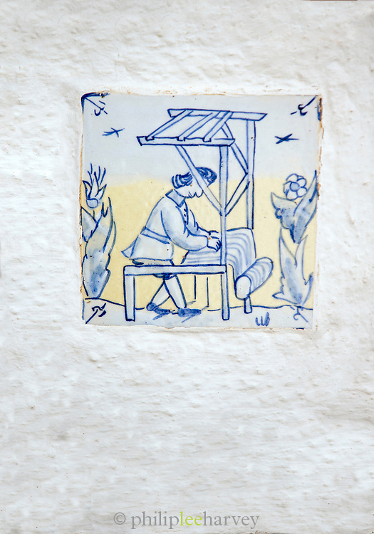 Close-up of decorative tile depicting working woman, Pampaneira, Andalusia, Spain
