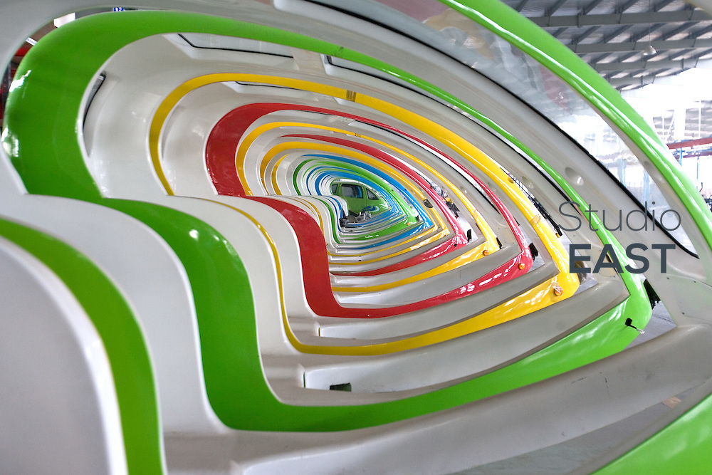 ZHEJIANG PROVINCE, CHINA - September 17: Colorful plastic shapes of what will become electric tricycle cabs in the Nederlands lay in Repow electric vehicles factory on September 17, 2007 in Jinhua, Zhejiang province, China. (Photo by Lucas Schifres/Getty Images)