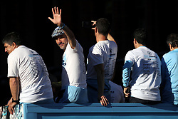 Manchester City manager Pep Guardiola waves to the crowds during the trophy parade in Manchester.