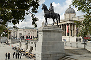 A top deck bus view of the northern end of Trafalgar Square, the statue of King George IV with a pigeon his head, an art insitution, the National Gallery, on 29th September 2020, in London, Westminster, England.