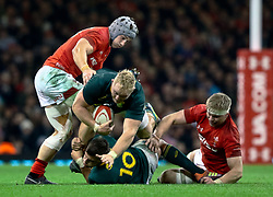 Vincent Koch of South Africa under pressure from Jonathan Davies of Wales<br /> <br /> Photographer Simon King/Replay Images<br /> <br /> Under Armour Series - Wales v South Africa - Saturday 24th November 2018 - Principality Stadium - Cardiff<br /> <br /> World Copyright © Replay Images . All rights reserved. info@replayimages.co.uk - http://replayimages.co.uk
