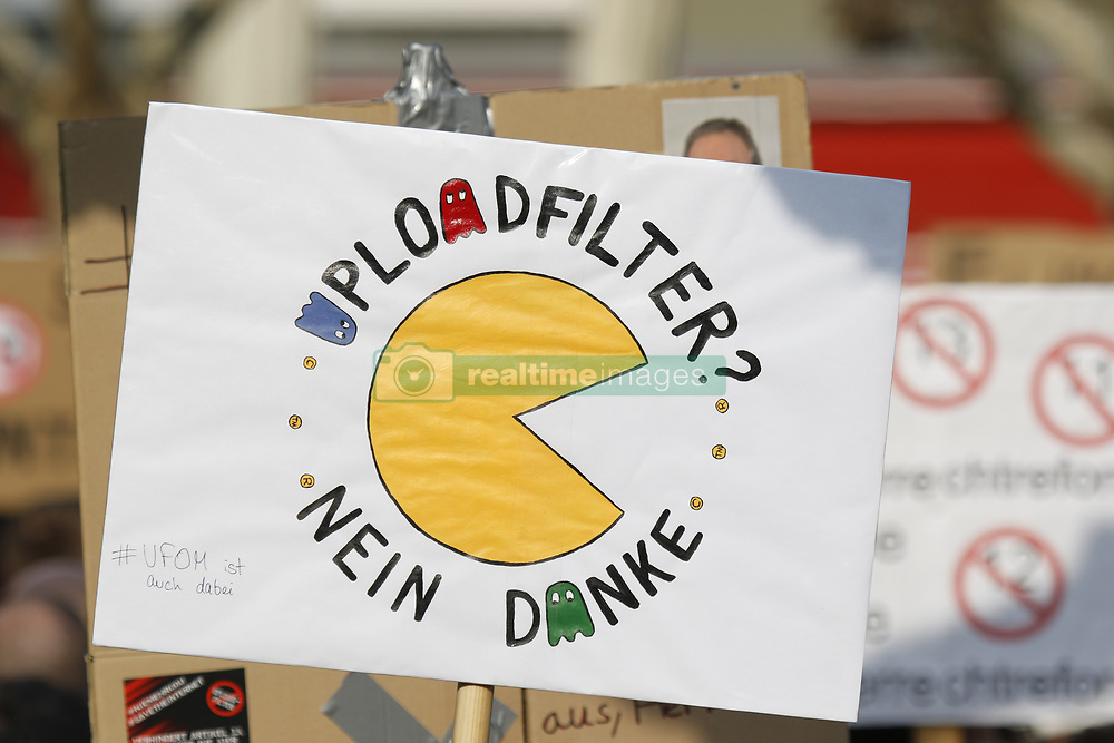 March 23, 2019 - Frankfurt, Hesse, Germany - A protester holds up a sign that reads ''Upload filters - no thanks''. More than 15,000 protesters marched through Frankfurt calling for the Internet to remain free and to not to pass the new EU Copyright Directive into law. The protest was part of a Germany wide day of protest against the EU directive. (Credit Image: © Michael Debets/Pacific Press via ZUMA Wire)