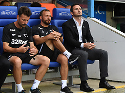 Derby County manager Frank Lampard (right), coach Jody Morris (centre) and coach Chris Jones (left) in the dugout