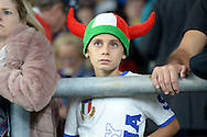 a Young Italian fan watching the match. Rugby World Cup 2015 pool D match, France v Italy at Twickenham Stadium in London on Saturday 19th September 2015.<br /> pic by John Patrick Fletcher, Andrew Orchard sports photography.