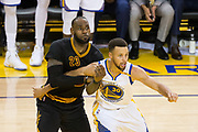 Golden State Warriors guard Stephen Curry (30) boxes out Cleveland Cavaliers forward LeBron James (23) during Game 2 of the NBA Finals at Oracle Arena in Oakland, Calif., on June 4, 2017. (Stan Olszewski/Special to S.F. Examiner)