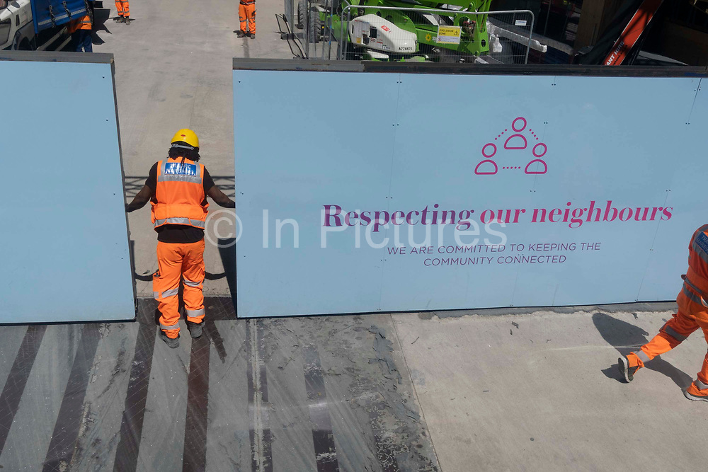 Construction workers on site at a location on Queen Victoria Street in Victoria, on 23rd June 2021, in Westminster, London, England.