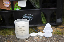 © Licensed to London News Pictures. 25/03/2016. <br /> <br /> Pictured: Tributes left for murdered Paige Doherty.<br /> <br /> Police Scotland have focused the centre of the murder investigation of 15 year old Paige Doherty in Clydebank, Glasgow around the home and business premises of suspect John Leathem as they search his house and Delicious Deli near Fleming Street, Clydebank Glasgow on Friday 25th March 2016.<br /> <br />  Photo credit should read Max Bryan/LNP