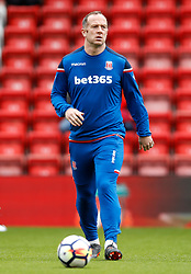 """Stoke City's Charlie Austin warms up prior to the Premier League match at Anfield, Liverpool. PRESS ASSOCIATION Photo. Picture date: Saturday April 28, 2018. See PA story SOCCER Liverpool. Photo credit should read: Martin Rickett/PA Wire. RESTRICTIONS:  EDITORIAL USE ONLY No use with unauthorised audio, video, data, fixture lists, club/league logos or """"live"""" services. Online in-match use limited to 75 images, no video emulation. No use in betting, games or single club/league/player publications."""