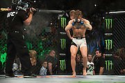Conor McGregor enters The Octagon against Chad Mendes during UFC 189 at the MGM Grand Garden Arena in Las Vegas, Nevada on July 11, 2015. (Cooper Neill)