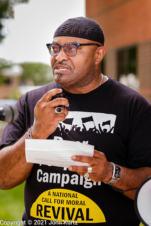 """07 JUNE 2021 - DES MOINES, IOWA: Rev. ABRAHAM L. FUNCHESS, from Jubalee United Methodist Church in Waterloo, IA, talks to people at a Moral Monday demonstration in Des Moines. About 20 representatives from The Poor People's Campaign in Des Moines gathered near the State Capitol for a """"National Call for Moral Revival."""" It was a part of a national effort to build a """"Third National Reconstruction."""" They called for a living wage that reflects the cost of living in Iowa (working at the state minimum wage, it takes 80 hours of work per week to afford a two bedroom apartment) and end military support for Iowa police agencies (between 2008-2014, Iowa law enforcement agencies got $7.7 million in military grade equipment.)          PHOTO BY JACK KURTZ"""