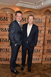Left to right, Fortnum & Mason's CEO EWAN VENTERS and TOM PARKER BOWLES at a party to celebrate the publication of 'Let's Eat meat' by Tom Parker Bowles held at Fortnum & Mason, Piccadilly, London on 21st October 2014.