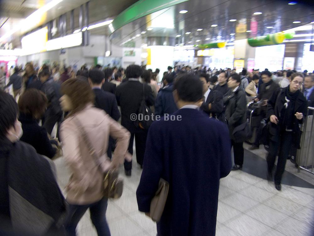 Rush hour crowds at the Shibuya train station