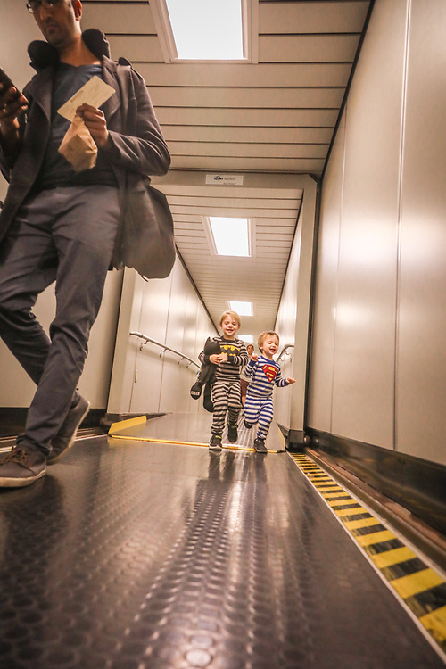 """""""Pretty much where ever we go, it's chaos.""""   -Kate Pace  comments about her sons Ryder (5) and Greason (2) as they sprint to board a plane to Kauai at the Oakland International Airport."""