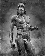 The Riace bronze Greek statue A cast about 460 BC. Museo Nazionale della Magna Grecia,  Reggio Calabria, Italy. Black and White Wall art print by Photographer Paul E Williams.<br /> <br /> There is a sense of movement in the statues their legs being bent as if they are about to take a step. Their heads are turned which accentuates a sense of anticipation as if they are looking for something. The anatomical detail is extraordinary which gives a startling realism to the statue and demonstarte the high level of skill of the Greek sculptors of this peiod. Museo Nazionale della Magna Grecia,  Reggio Calabria, Italy. Black and White Wall art print by Photographer Paul E Williams .<br /> <br /> If you prefer visit our World Gallery Print Shop To buy a selection of our prints and framed prints desptached  with a 30-day money-back guarantee and is dispatched from 16 high quality photo art printers based around the world. ( not all photos in this archive are available in this shop) https://funkystock.photoshelter.com/p/world-print-gallery<br /> <br /> Visit our HISTORIC WALL ART PRINT COLLECTIONS for more photo prints https://funkystock.photoshelter.com/gallery-collection/Historic-Antiquities-Photo-Wall-Art-Prints-by-Photographer-Paul-E-Williams/C00002uapXzaCx7Y<br /> <br /> Visit our Museum ART & ANTIQUITIES COLLECTIONS to browse more photo at: https://funkystock.photoshelter.com/p/museum-antiquities Visit our World Gallery Print Shop To buy a selection of our prints and framed prints desptached  with a 30-day money-back guarantee and is dispatched from 16 high quality photo art printers based around the world.