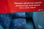 With the UK's Coronavirus pandemic lockdown easing with preparations going ahead for the opening of more public transport and services plus shops, another 151 have died from Covid-19 bringing the total in the last 24hrs to 41,279. Tape has been stretched across seating on a London bus to stop their use, while being passengers are being asked to wear face coverings and to stay apart which in line with government requirements for all users of public trransport starting next Monday (15th June), on 11th June 2020, in London, England.