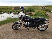 Salthouse, Norfolk, England 17/06/2013.<br /> Moto Guzzi Bellagio on the coast road.