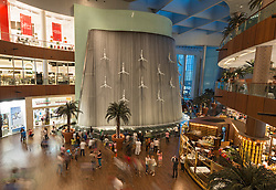 View of waterfall and interior of busy Dubai Mall in United Arab Emirates UAE