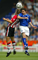 Photo Aidan Ellis.<br />Leicester City v Southampton (FA Barclaycard Premiership) 16/08/2003.<br />Leicester's Muzzy Izzet and Southampton's Anders Svensson.