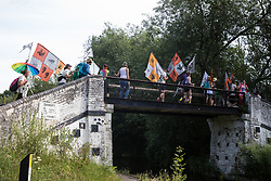 Denham, UK. 26 June, 2020. Activists from HS2 Rebellion and Extinction Rebellion UK take part in a 'Rebel Trail' hike along the route of the HS2 high-speed rail link from Birmingham to London. The activists, who departed from Birmingham on 20th June and will arrive outside Parliament in London on 27th June, are protesting against the environmental impact of the high-speed rail link and questioning the viability of the £100bn+ project.