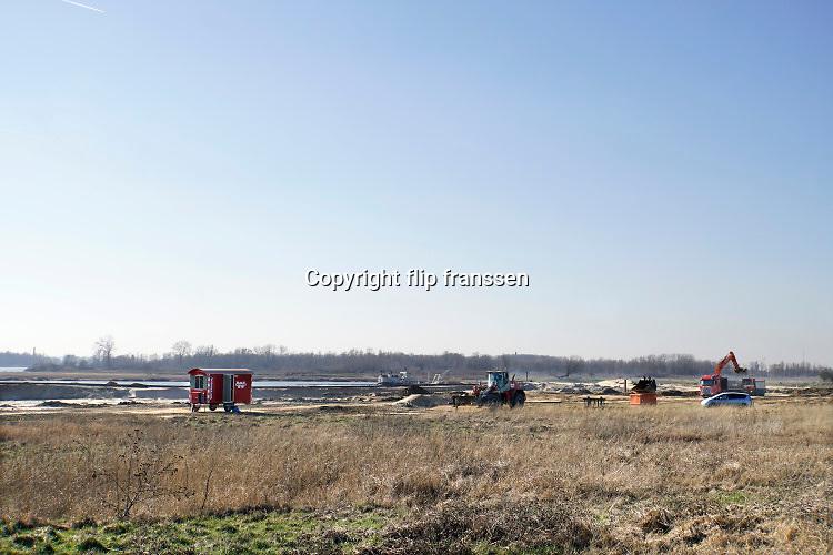 Nederland, Nijmegen, Kekerdom, 1-3-2019Herinrichting Millinger Waard . Het gebied wordt nog meer voorzien van geulen waar water in kan overlopen en natuur een eigen ecosysteem kan ontwikkelen . Staatsbosbeheer en rijkswaterstaat leggen natuurgebieden aan in de uiterwaarden van de grote rivieren . Natuurontwikkeling in de uiterwaarden en rivierverruimende projecten voor een betere afvoer van het water . Ruimte voor de rivier .Foto: Flip Franssen
