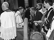 Episcopal Ordination Of Desmond Connell. (R74).1988..06.03.1988..03.06.1988..6th March 1988..Following the death of Archbishop Kevin McNamara in April '87, Pope John Paul II surprisingly nominated Desmond Connell for the position of Archbishop of Dublin. The ordination of Dr Connell took place at the Pro-Cathedral in Dublin...Image shows An Taoiseach, Charles Haughey, shaking hands with a member of the clergy during the mass in the Pro-Cathedral.