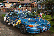 Car in Cannon Beach adorned in every manner of Chatches.