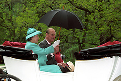 06/05/1993. Queen Elizabeth II and the Duke of Edinburgh share an umbrella whilst enjoying a horse-drawn carriage ride at Bugacs, on the Hungarian Plain during a State Visit to Hungary. The Royal couple will celebrate their platinum wedding anniversary on November 20.