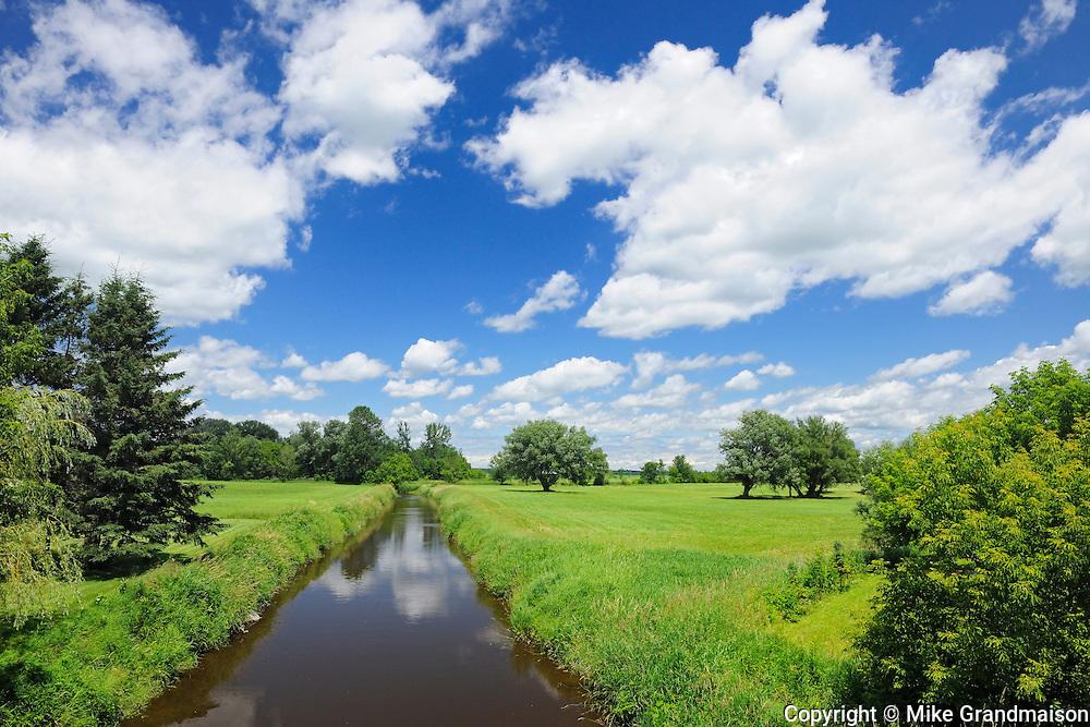 river and clouds<br /> Notre Dame de Stanbridge<br /> Quebec<br /> Canada