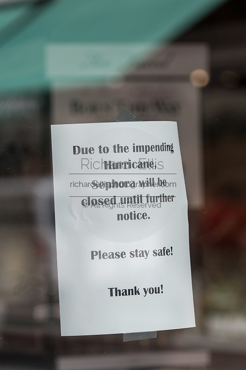 Sign on a shop saying closed for the hurricane on the historic King Street shopping district in preparation for approaching Hurricane Florence September 11, 2018 in Charleston, South Carolina. Florence, a category 4 storm, is expected to hit the coast between South and North Carolina and could be the strongest storm on record for the East Coast of the United States.