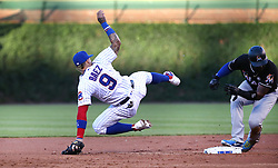 June 6, 2017 - Chicago, IL, USA - Chicago Cubs second baseman Javier Baez (9) falls to the ground after forcing Miami Marlins baserunner Marcell Ozuna at second base on a run-scoring play in the first inning at Wrigley Field in Chicago on Tuesday, June 6, 2017. (Credit Image: © Chris Sweda/TNS via ZUMA Wire)