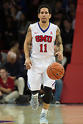 DALLAS, TX - DECEMBER 16: Nic Moore #11 of the SMU Mustangs brings the ball up court against the Nicholls State Colonels on December 16, 2015 at Moody Coliseum in Dallas, Texas.  (Photo by Cooper Neill/Getty Images) *** Local Caption *** Nic Moore