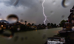 May 30, 2017 - Srinagar, Jammu and Kashmir, India - Lightning strikes over the river Jehlum on May 30, 2017 in Srinagar, the summer capital of Indian administered Kashmir, India. A hailstorm coupled with lightning and thunder lashed out on Srinagar overnight. There were no immediate reports about damage to houses or orchards. Photo by Yawar Nazir. (Credit Image: © Yawar Nazir via ZUMA Wire)