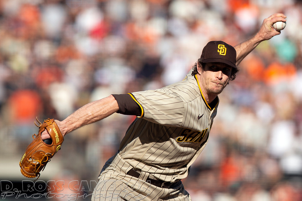 San Diego Padres pitcher Tim Hill (25) delivers a pitch against the San Francisco Giants during the ninth inning of a baseball game, Saturday, Oct. 2, 2021, in San Francisco. Hill was the winning pitcher in the Padres' extra inning victory. (AP Photo/D. Ross Cameron)