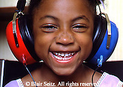 Medical Doctor's Office Hearing Test, African American Child, Happy Response