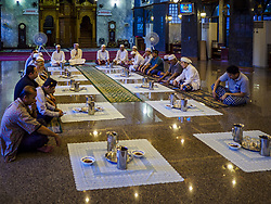 June 14, 2017 - Bangkok, Bangkok, Thailand - Men pray before Iftar at Masjid Hidayatun Islam. Iftar is the evening meal when Muslims end their daily Ramadan fast at sunset. Iftar is a communal event at Masjid Hidayatun Islam and more than a hundred people usually attend the meal. (Credit Image: © Jack Kurtz via ZUMA Wire)