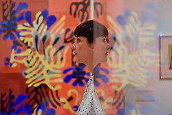 """© Licensed to London News Pictures. 01/08/2017. London, UK. A staff member is reflected against """"""""Mimosa"""", 1949-51. Preview of """"Matisse in the Studio"""", at the Royal Academy of Arts, Piccadilly, the first exhibition to consider how the personal collection of treasured objects of Henri Matisse were both subject matter and inspiration for his work.  Around 35 objects are displayed alongside 65 of Matisse's paintings, sculptures, drawings, prints and cut-outs.  The exhibition runs 5 August to 12 November 2017.  Photo credit : Stephen Chung/LNP"""
