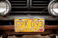 Scenes from Newport, Oregon including fishing boats and the Yaquina bridge and crabbing baskets. An old Oregon license plate on an old truck.