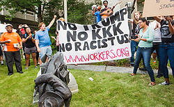 Protesters celebrate after toplling a statue of a Confederate solder in downtown Durham, NC, USA, Monday afternoon, August 14, 2017. The crowd gathered to protest the violence in Charlottesville, Va. following a march by white supremacists on Saturday. Photo by Casey Toth/The Herald-Sun/TNS/ABACAPRESS.COM