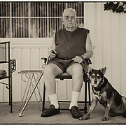 Harley Sprague, 91, of Gladstone, served during World War II as a staff sergeant, mechanic, 10th Repair Squadron, 10th Air Depot Group. Sprague sat for a portrait outside his home with his dog, Lyric.