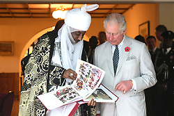The Prince of Wales receives a book as a gift from the Emir of Kano, during a meeting with Traditional Leaders at the High Commissioner's Residence in Nigeria, on day seven of his trip to west Africa with the Duchess of Cornwall.