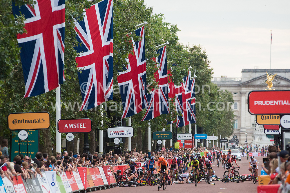 London, UK. 3 August, 2019. A collision on the Mall just before the finishing line for the Prudential RideLondon Classique. The Classique, which is the richest one-day women's race in the world, covers 20 laps of a tight circuit of 3.4 kilometres around St James's Park and Constitution Hill. Defending champion Kirsten Wild, who crossed the finishing line first, was disqualified following the collision.