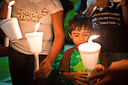 """Sept. 19 - PHOENIX, AZ: Children with candles support the DREAM Act in front of Sen. John McCain's office in Phoenix Sunday night. About 30 people met in front of US Sen. John McCain's office in Phoenix Sunday night to demonstrate in support of the DREAM Act, which is scheduled to be debated in the US Senate on Tuesday, Sept 21. The Development, Relief and Education for Alien Minors Act (The """"DREAM Act"""") is a piece of proposed federal legislation in the United States that was introduced in the United States Senate, and the United States House of Representatives on March 26, 2009. This bill would provide certain illegal immigrant students who graduate from US high schools, who are of good moral character, arrived in the U.S. as minors, and have been in the country continuously for at least five years prior to the bill's enactment, the opportunity to earn conditional permanent residency. In the early part of this decade McCain supported legislation similar to the DREAM Act, but his position on immigration has hardened in the last two years and he no longer supports it. The protesters, mostly area students, marched and drilled to show their support for the US military and then held a candle light vigil.   Photo by Jack Kurtz"""