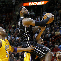 19 January 2012: Miami Heat small forward LeBron James (6) goes for the lay up past Los Angeles Lakers shooting guard Kobe Bryant (24) during the Miami Heat 98-87 victory over the Los Angeles Lakers at the AmericanAirlines Arena, Miami, Florida, USA.