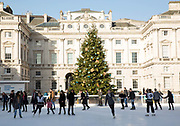 Christmas ice skating at Somerset House on the 11th December 2018 in London in the United Kingdom. Somerset House is a Neoclassical building on the south side of the Strand, overlooking the River Thames.