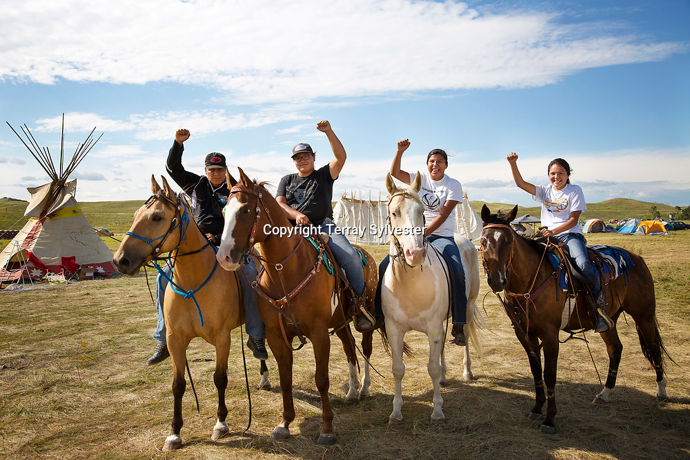 From left, Hiesen Different Horse, Gaberielle Bird Horse, Malania Fast Horse, and Hailee Little Eagle pose for a portrait in the resistance camp against the Dakota Access oil pipeline on August 26, 2016. Cannon Ball, North Dakota, United States.